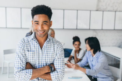 man smiling in a classroom